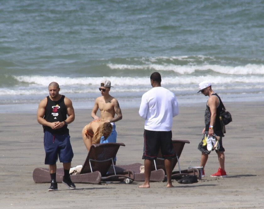 Pop star Justin Bieber, third from left, was in Panama over the weekend but was reportedly headed back to the United States, where he'll face arraignment in a DUI case.