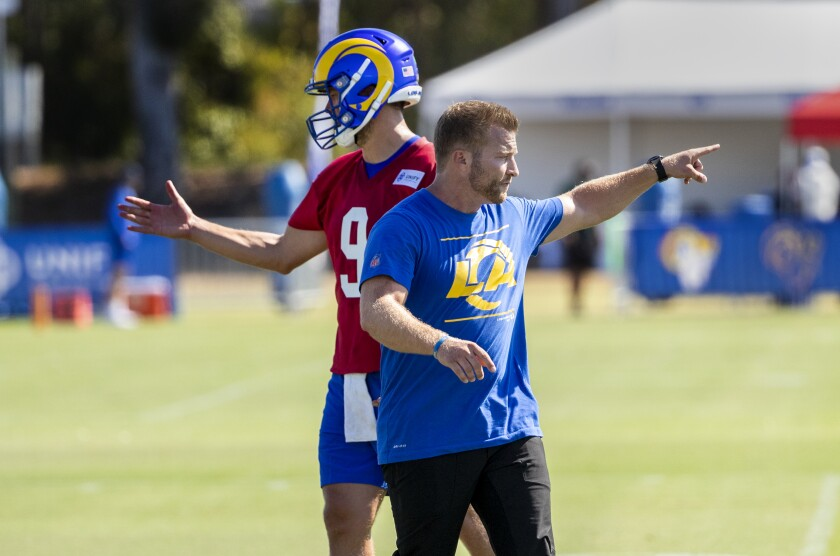 Rams coach Sean McVay and starting quarterback Matthew Stafford give direction during camp.