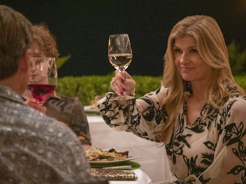 """Connie Britton raises a glass in the HBO series """"The White Lotus."""""""