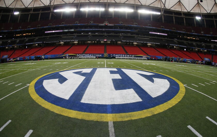 The SEC logo is displayed on a football field