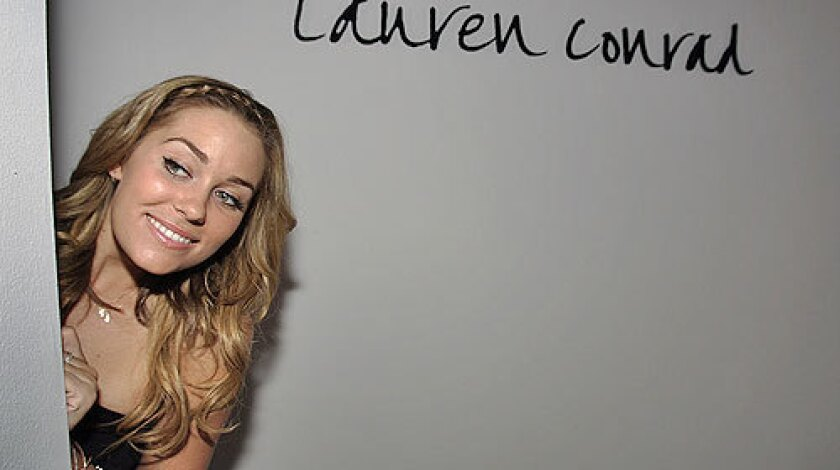 Lauren Conrad, peeking at the gathering crowd before her show, will create a dress for this year's Emmys.