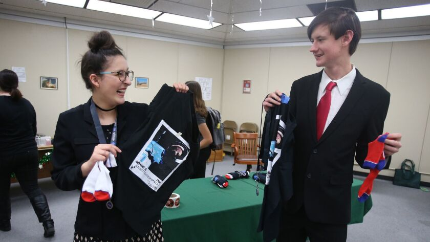 Students Jessi Diment and Colby Peterson, from left, happily open NASA gift bags brought by space in
