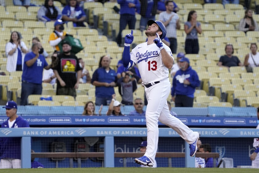 Los Angeles Dodgers' Max Muncy gestures before scoring after hitting a two-run home run during the first inning of a baseball game against the Texas Rangers Friday, June 11, 2021, in Los Angeles. (AP Photo/Mark J. Terrill)