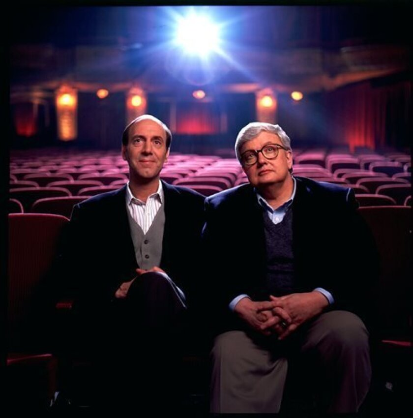 FILE - This undated file photo originally released by Disney-ABC Domestic Television, shows movie critics Roger Ebert, right, and Gene Siskel. The Chicago Sun-Times is reporting that its film critic Roger Ebert died on Thursday, April 4, 2013. He was 70. Ebert and Siskel, who died in 1999, trademar
