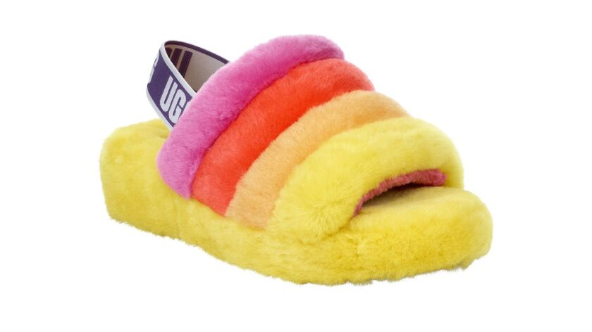 From UGG is a limited edition unisex slide inspired by the Pride flag Credit - UGG