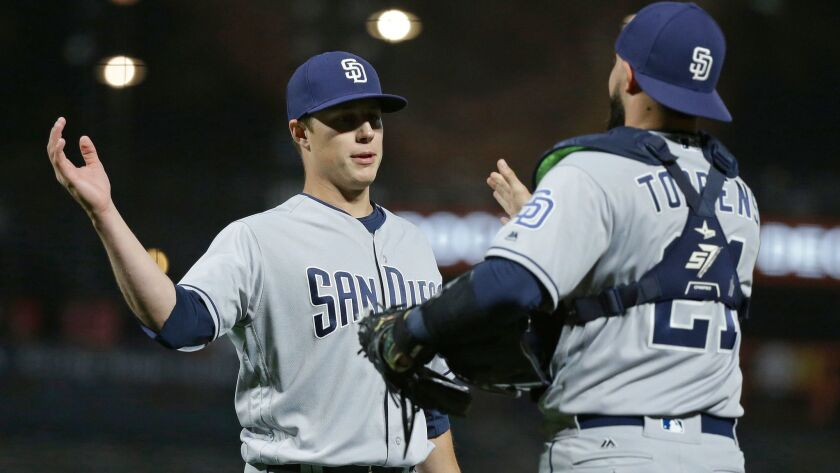 San Diego Padres relief pitcher Phil Maton, left, is greeted by catcher Luis Torrens, left, at the end of their baseball game against the San Francisco Giants Saturday, July 22, 2017, in San Francisco. San Diego won the game 12-9.