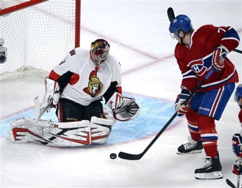 Ottawa Senators goalie Craig Anderson (41) stops Montreal Canadiens right wing Michael Ryder (73) during the first period of Game 1 of an NHL hockey Stanley Cup playoffs first-round series in Montreal on Thursday, May 2, 2013. (AP Photo/The Canadian Press, Ryan Remiorz)