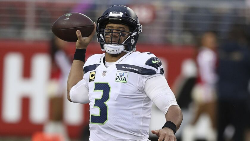 Russell Wilson of the Seattle Seahawks passes the ball against the San Francisco 49ers during the Ni