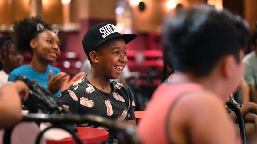 LOS ANGELES, CALIFORNIA JULY 7, 2018-At-risk kids laugh at jokes at the Laugh Factory in Los Angeles