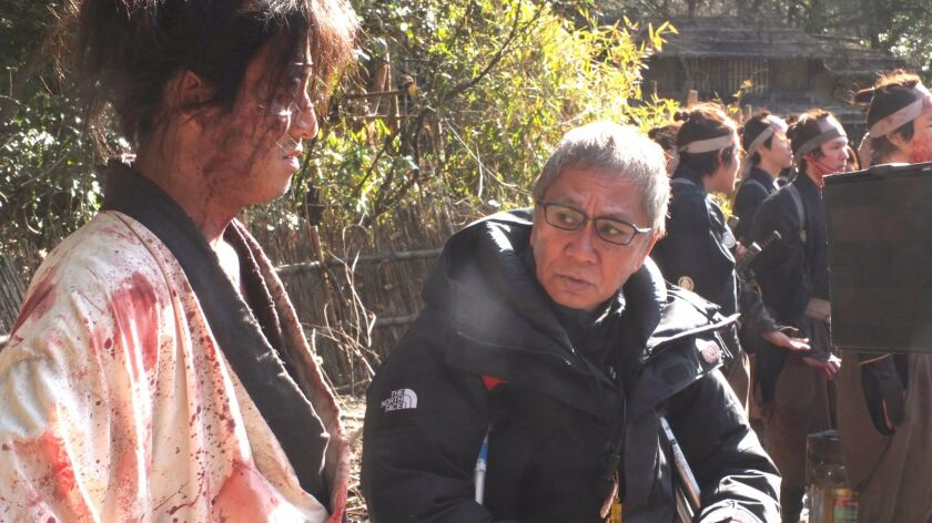 "Director Takashi Miike on the set of ""Blade of the Immortal."""