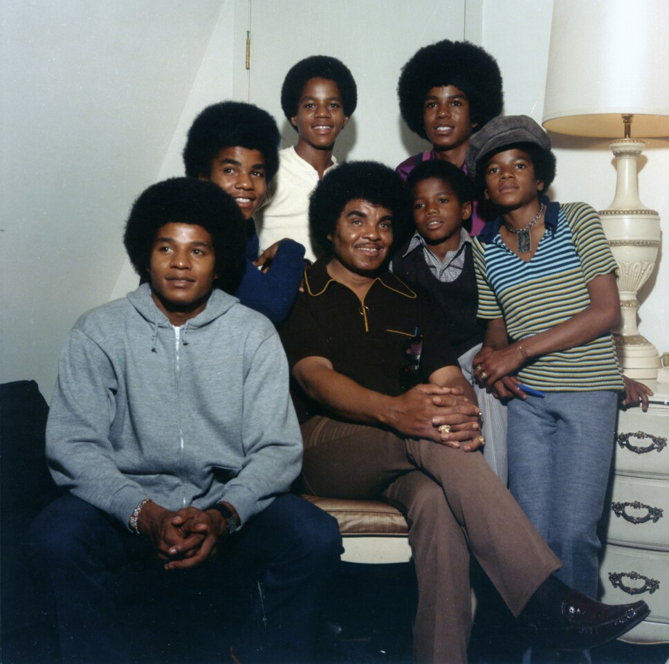 Joe Jackson is surrounded by the Jackson 5, circa 1970. Clockwise from bottom left are sons Jackie, Tito, Marlon, Jermaine, Michael and Randy.