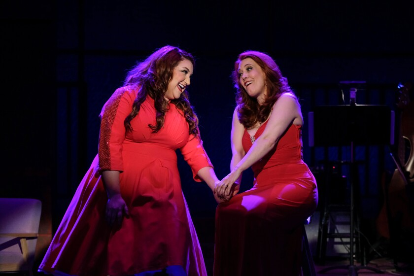 """Bethany Slomka and Misty Cotton perform a duet in """"Welkome Home for the Holidays!"""" at the Welk Resort Theatre in Escondido."""