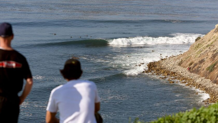 Cory Spencer, left, and Christopher Taloa watch the waves at Lunada Bay during a Martin Luther King Jr. Day event to protest the localism that has plagued the surf spot on the Palos Verdes Peninsula.