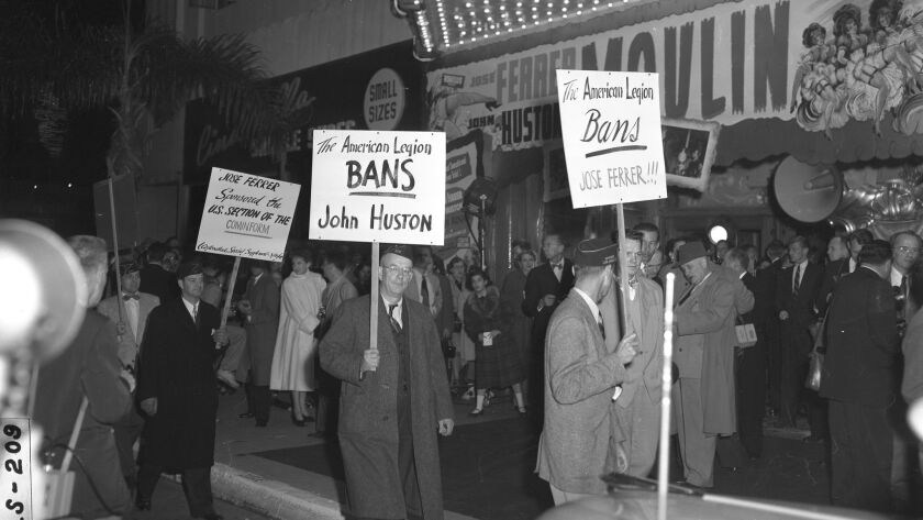 """Anti-communist members of the American Legion Un-American Activities committee picket the opening of """"Moulin Rouge"""" in front of the Fox Wilshire Theater in Beverly Hills on Dec. 23, 1952."""
