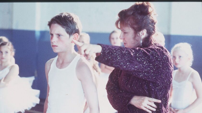 11–year–old Billy (Jamie Bell) in dance class with his instructor Mrs Wilkinson (Julie Walters) in U