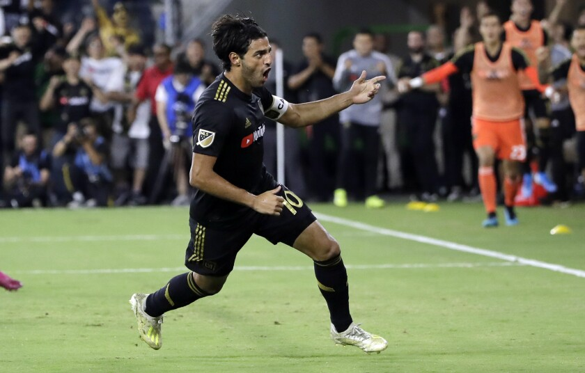 LAFC's Carlos Vela celebrates after scoring against the Galaxy during the second half of a 3-3 tie on Sunday.