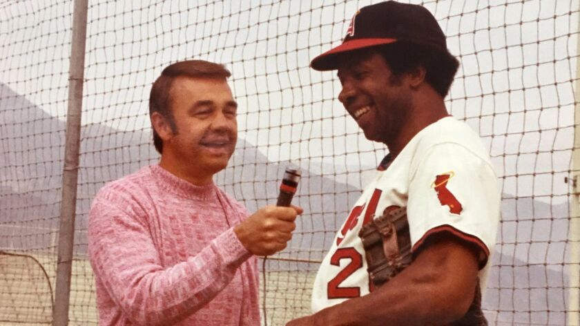 Dick Enberg interviews Hall of Fame baseball player Frank Robinson of the California Angels during spring training in early 1970s.
