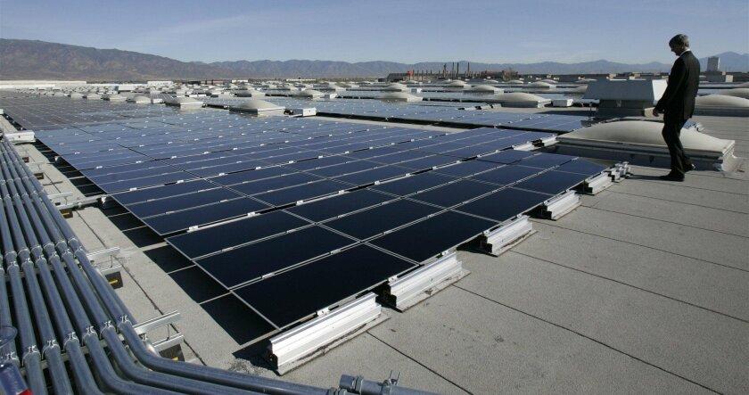 Solar panels fan out across a distribution warehouse in Fontana.