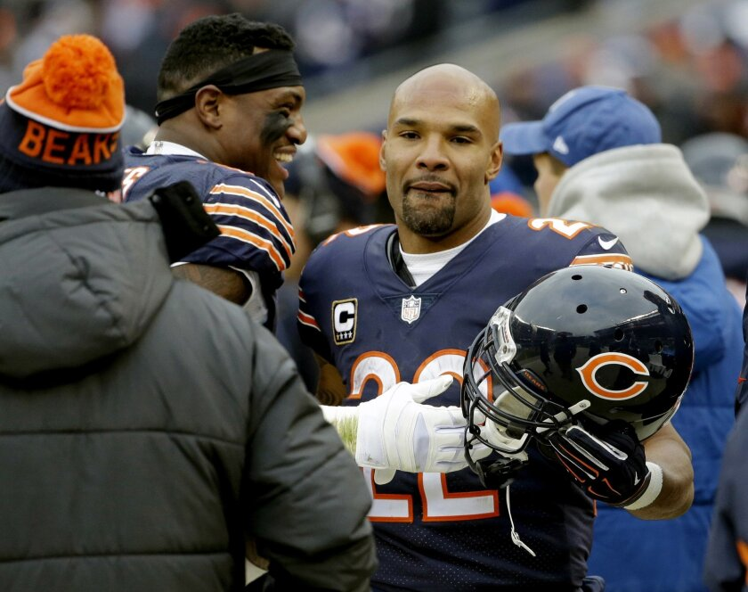 FILE - In this Jan. 3, 2016 file photo, Chicago Bears running back Matt Forte (22) is congratulated on the sideline after scoring a touchdown against the Detroit Lions during an NFL football game in Chicago. Forte, a two-time Pro Bowl running back, announced on Instagram Friday, Feb. 12, 2016, that