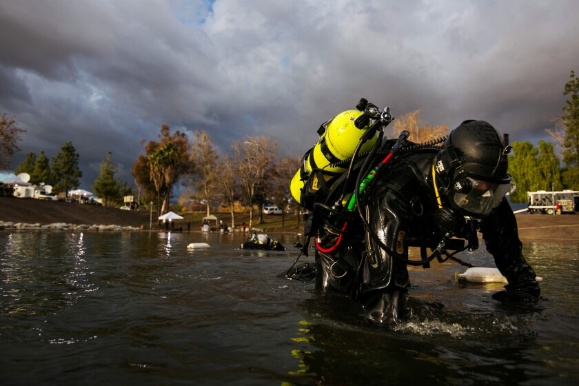 FBI dive team search the bottom of Seccombe Lake for electronic devices or other evidence possibly disposed in the lake as they continue to investigate the terrorist attack in San Bernardino.