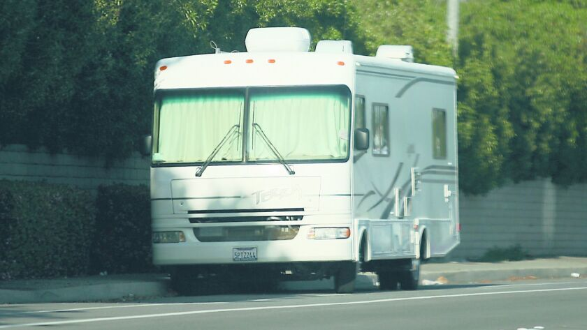 A new ordinance would restrict large recreational vehicles, such as this one on Hamilton Avenue, from parking on any public street, highway or alley in Huntington Beach without a permit.