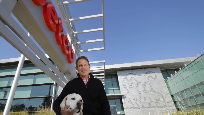 Ron Coughlin, Petco CEO, with his dog, Yummy, a yellow Labrador Retriever, at the company headquarters in Rancho Bernardo.