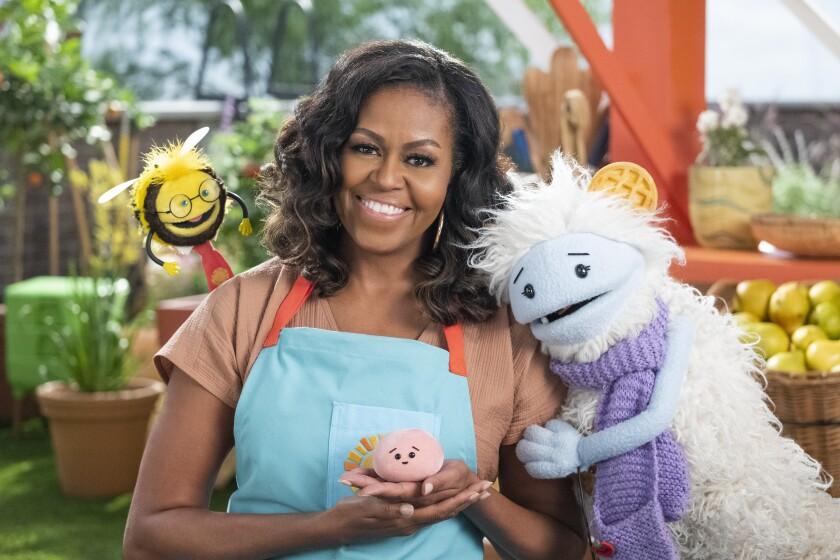 En esta imagen difundida por Netflix, la ex primera dama estadounidense Michelle Obama con Busy