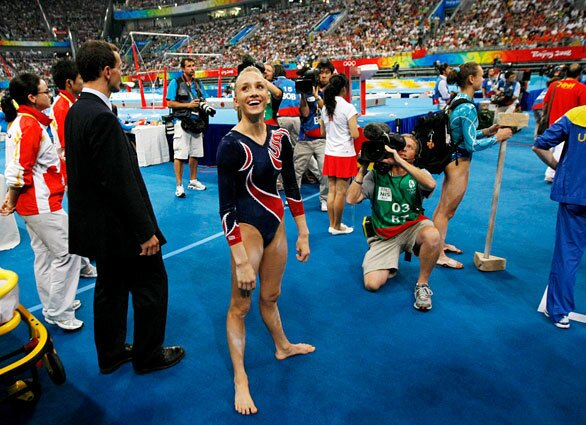 U.S. gymnast Nastia Liukin seems to be in good spirits after learning that she won the silver medal in uneven bars. She had the same score as China's He Kexin, who took the gold.