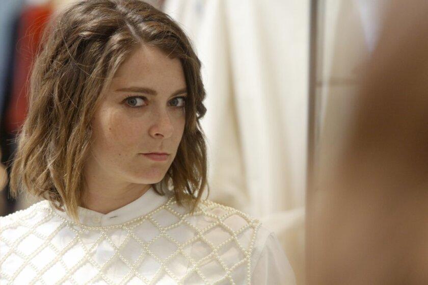 Rachel Bloom tries on a Dries Van Noten clothing