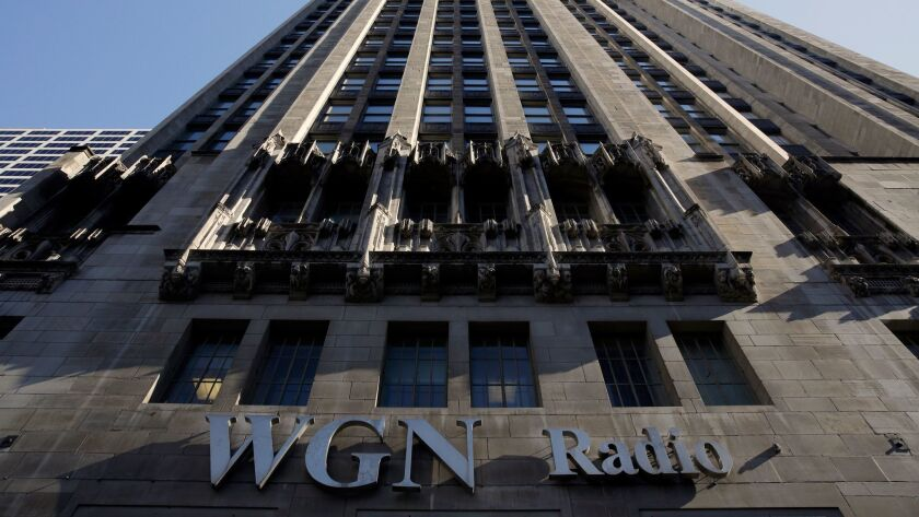 The WGN Radio sign appears on the side of Tribune Tower in Chicago.