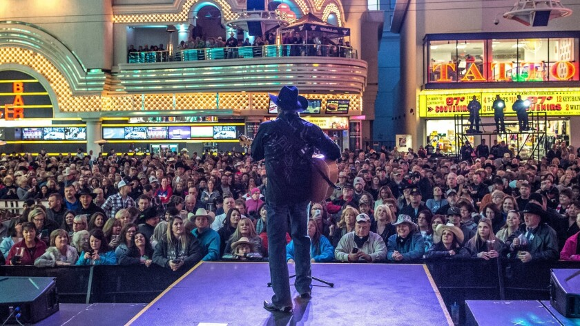 Fans crowd Fremont Street Experience for the 2015 Downtown Hoedown, an evening of free concerts to kick off the rodeo.