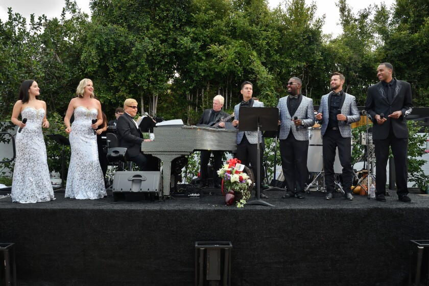 Wayne Foster's orchestra performing, with Wayne himself at the piano