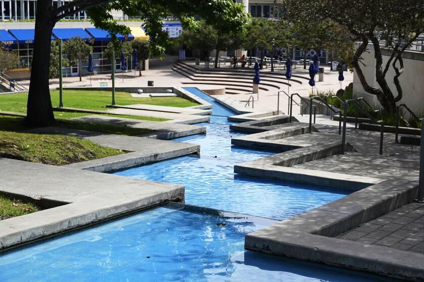 A decorative pool zig-zags through a plaza at UC San Diego