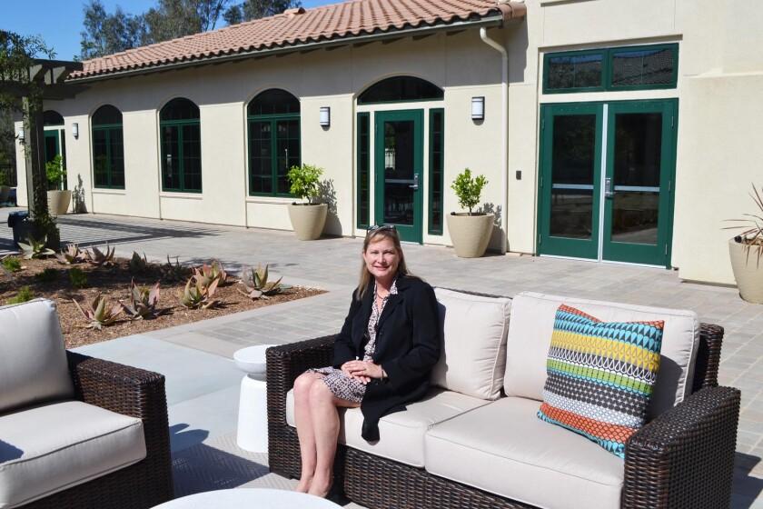 Villa de Vida Inc. Executive Director Hunter Christian in the complex's courtyard.
