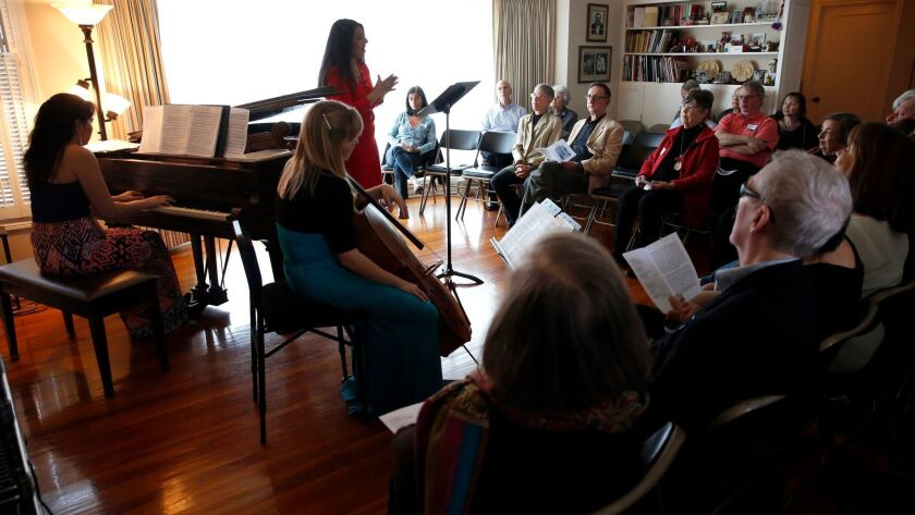 Pianist Ines Irawati, far left, produces concerts like this, at the La Jolla home of Marty and Sherry Bloom.