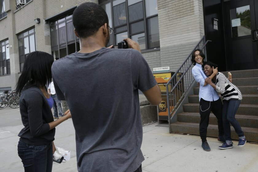 In this Friday, June 5, 2015 photo, Roshana Paul, left, Dexter Dugar Jr., second from left,  Justin Casquejo, second from right, and Tayana Brumaire make a short film in New York. This summer, thousands of young people will go to camp, attend prestigious academic programs and even study filmmaking