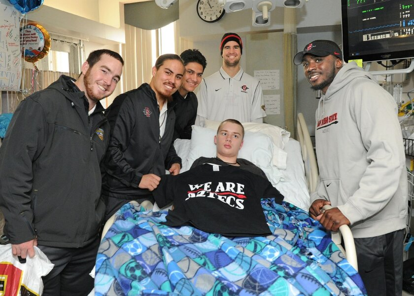 San Diego State players (from left) Wes Feer, Jake Fely, Sam Meredith, Jake Bernards and Gabe Lemon pose for a picture with Colin Steppe, a freshman football player at Meridian (Idaho) High School who suffers from a condition called posterior fossa, which has resulted in him losing movement in his