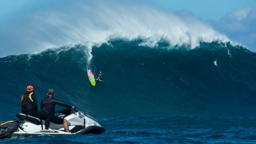 Paige Alms falling in heat 1 at the Pe'ahi Women's Challenge