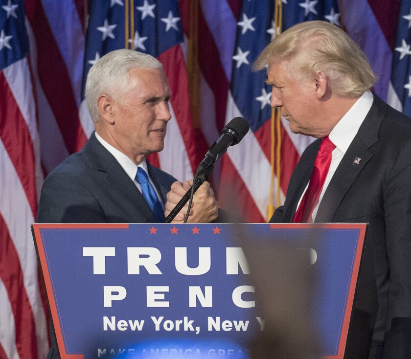 Mike Pence, left, and President Trump celebrate on election night in 2016.
