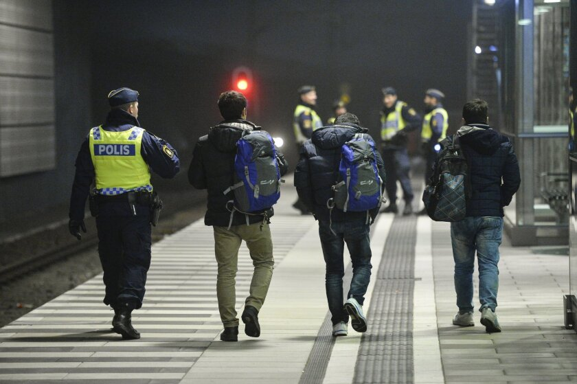 FILE - In this Dec. 17, 2015 file photo, the police escort 3 men from a train at Hyllie station outside Malmo, Sweden. Interior Minister Anders Ygeman says Sweden could deport between 60,000 and 80,000 asylum-seekers in coming years. Ygeman told newspaper Dagens Industri that since about 45 percent of asylum applications are currently rejected, the country must get ready to send back tens of thousands of the 163,000 who sought shelter in Sweden last year, it was reported on Thursday, Jan. 28, 2016. (Johan Nilsson /TT News Agency via AP, File)
