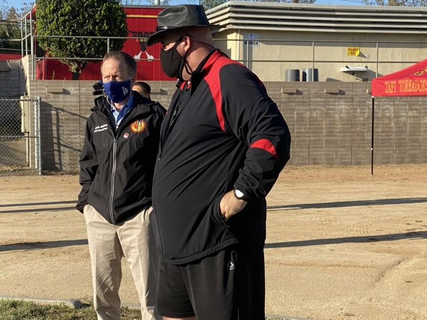 LAUSD Supt. Austin Beutnertalking with Taft football coach Aron Gideon.