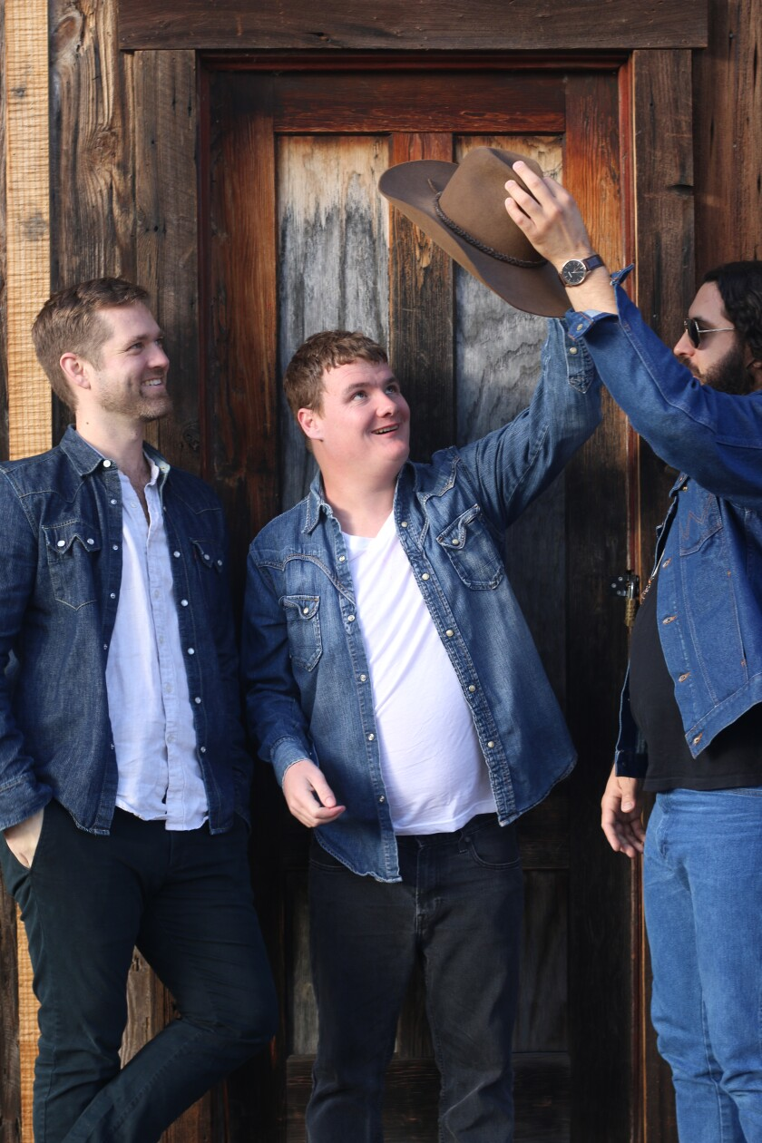 "Heath Farmer, Reid Moriarty and Steven Crowle of Jungle Poppins released ""Slightly Country."""