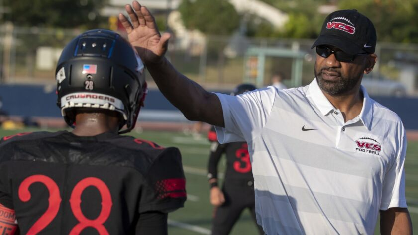 BURBANK, CALIF. -- FRIDAY, AUGUST 17, 2018: Village Christian offensive line Todd McNair talks with