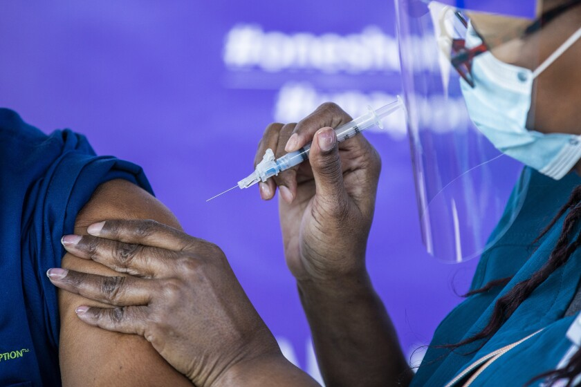 COVID-19 vaccine being administered