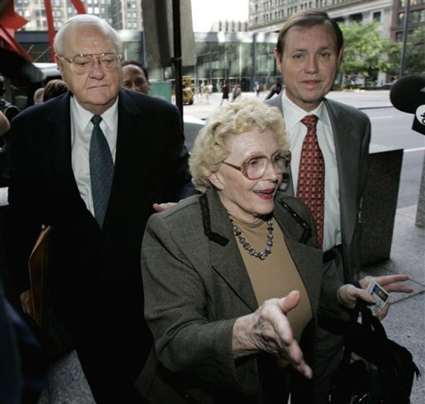 FILE - In this Sept. 28, 2005 file photo, former Illinois Gov. George Ryan, left, arrives with his wife Lura Lynn, center, and attorney Dan Webb at the Dirksen Federal Building in Chicago for the first day of opening arguments in his racketeering trial. On Friday, Jan. 7, 2011, federal prosecutors say Ryan has already had a visit with his ailing wife and so they oppose a motion to let him out of jail on bail. The federal filing says the Bureau of Prisons granted Ryan an escorted trip to the Kankakee hospital Wednesday evening where his wife is being treated. (AP Photo/Charles Rex Arbogast, File)