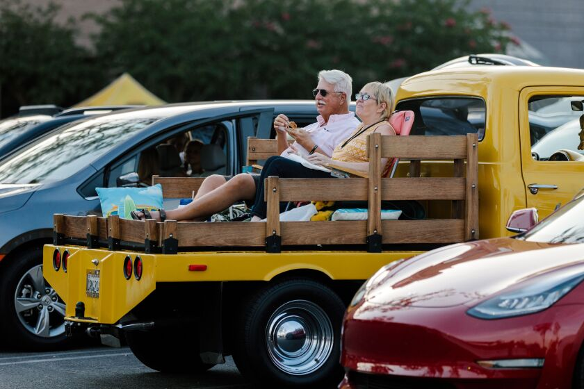 A truck flatbed provides a great view for movie goers at the California Center for the Arts' drive-in at Westfield mall.