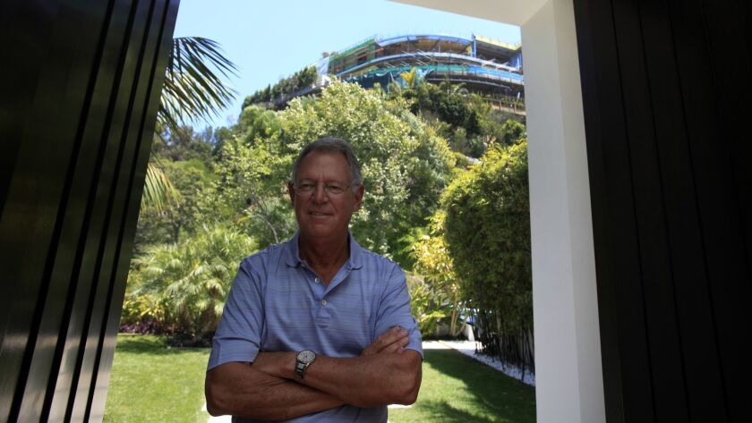 LOS ANGELES, CA - JULY 02, 2014: Portrait of Joseph Horacek, standing at the entrance to his Balines
