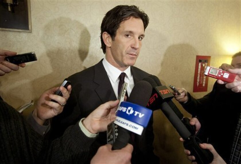 FILE - This Nov. 9, 2010 file photo shows NHL vice president Brendan Shanahan speaking to reporters during the annual fall meeting of the hockey league's general managers, in Toronto. Choosing not to follow the lead of the many minor and youth leagues that have banned all hits to the head, the NHL is instead cracking down on them case-by-case. New discipline czar Brendan Shanahan, only three years removed from his playing days, has been suspending players for the most egregious hits, and the message appears to be getting through. (AP Photo/The Canadian Press, Darren Calabrese, File)