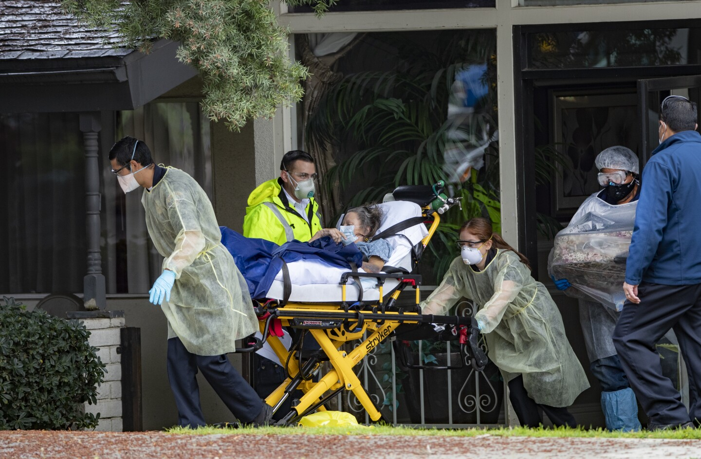 RIVERSIDE, CA- APRIL 8, 2020: Patients are removed from Magnolia Rehabilitation and Nursing Center after 39 tested positive for coronavirus and nursing staff was not showing up to work for their own safety on April 8, 2020 in Riverside, California.(Gina Ferazzi / Los Angeles Times)