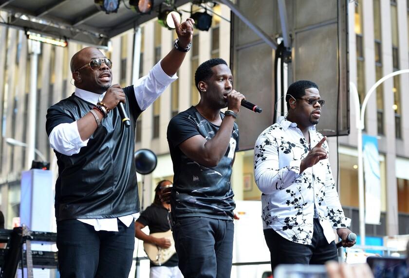Wanya Morris, Shawn Stockman and Nathan Morris of Boyz II Men perform.